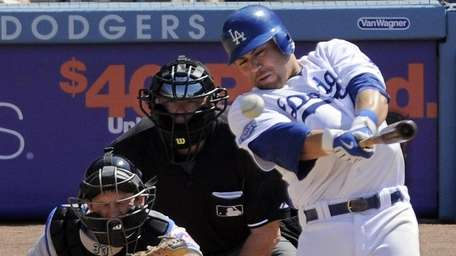 Los Angeles Dodgers Russell Martin, right, hits an