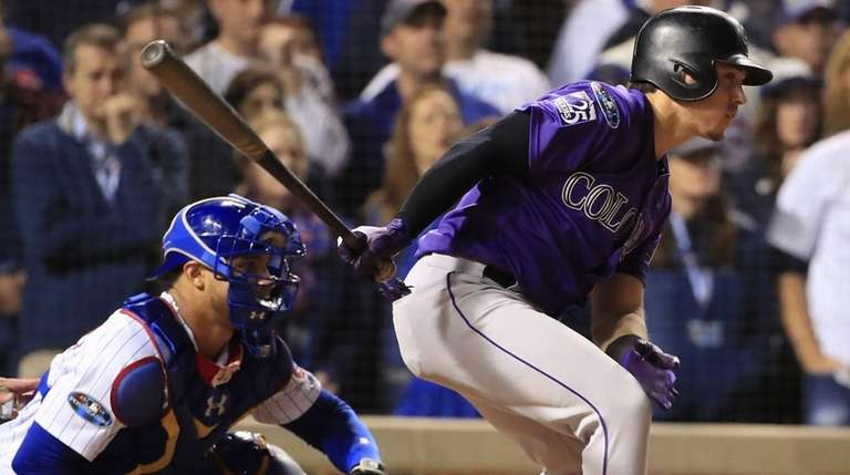 Colorado's Tony Wolters gets a base hit to