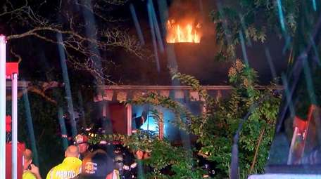Firefighters at a house fire in Yaphank on