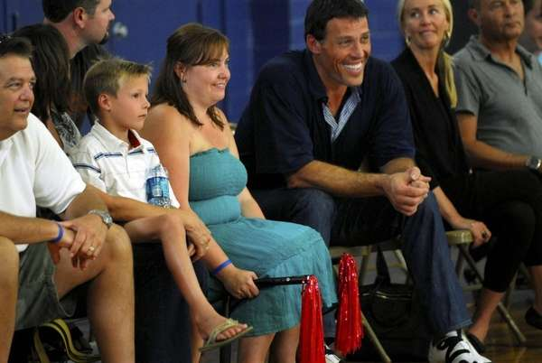 Kristin Alioto, left, and host Tony Robbins in