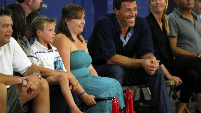 Kristin Alioto, left, and host Tony Robbins in
