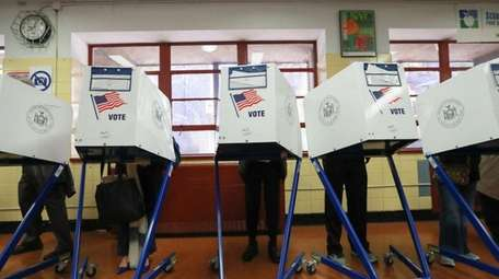 Voting booths are shown in this undated photo.