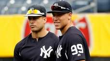 Yankees outfielders Giancarlo Stanton, left, and Aaron Judge