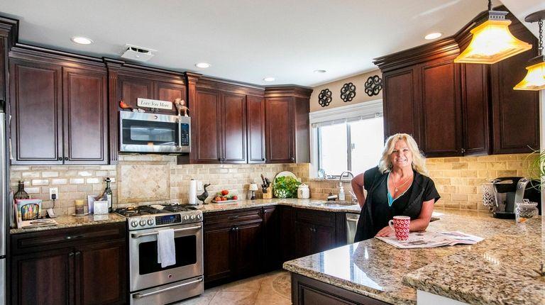 Marleen Rogers in her kitchen in West Islip.