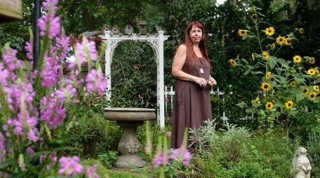 Kelly White-Rubin in the backyard garden  she