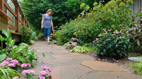Vera Capogna walks a path in her Sayville