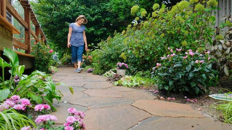 Vera Capogna walks a path in her Sayville