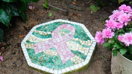 A pink breast cancer ribbon mosaic tile, handmade