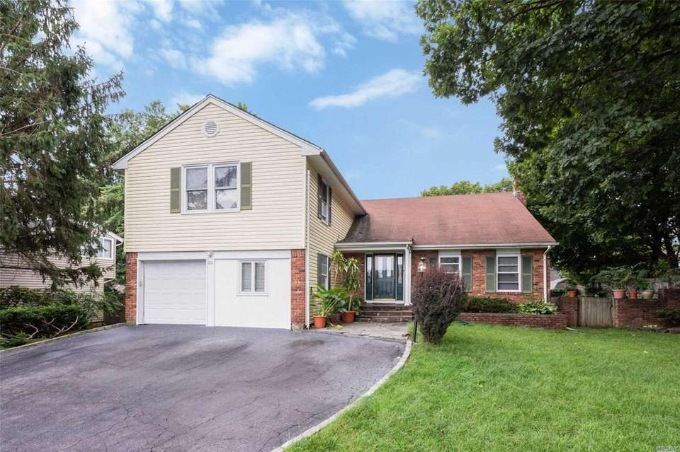 This Glen Cove split-level includes five bedrooms and