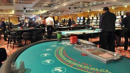 Some of the gaming tables aboard the Escapade,