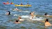 Swimmers begin a 3.5 nautical mile swim off