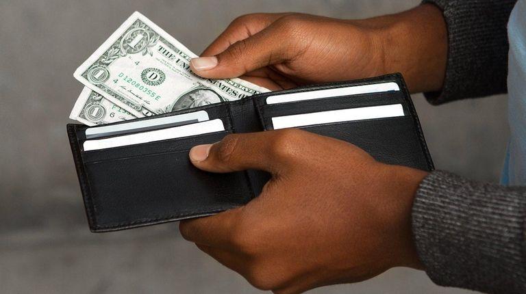 Dollar bills in a wallet.
