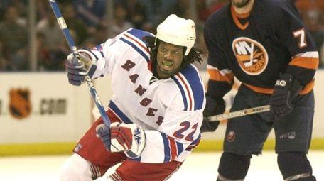 Anson Carter skates down ice the Rangers' 4-2