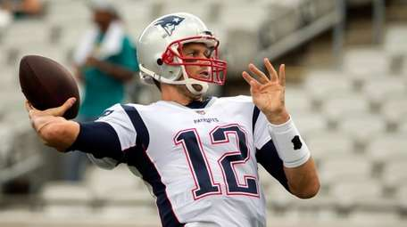 Patriots quarterback Tom Brady (12) throws the ball