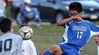 Herricks' Josh Cabahug tries to score during a