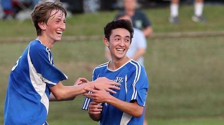 Herricks' Kenny Gensch, left, and Dylan Dotan celebrate