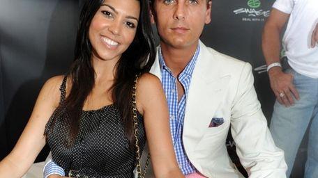 Kourtney Kardashian and Scott Disick at the SWAGG