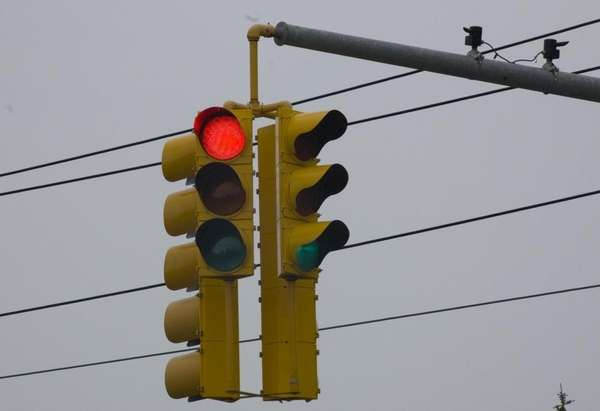 A red light is monitored by camera, located