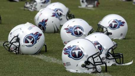 Tennessee Titans helmets sit on the field during
