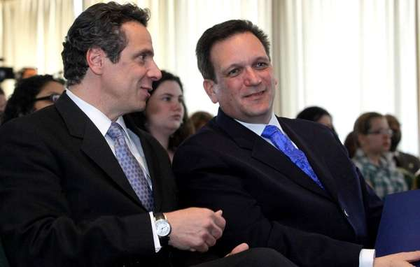 State Attorney General Andrew Cuomo, left, speaks with