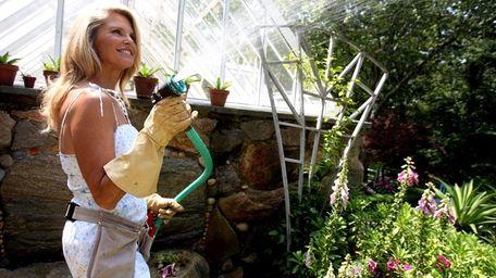 Christie Brinkley works in her garden at her