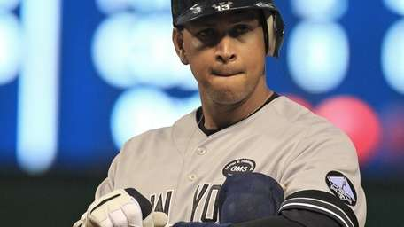 New York Yankees' Alex Rodriguez takes off his