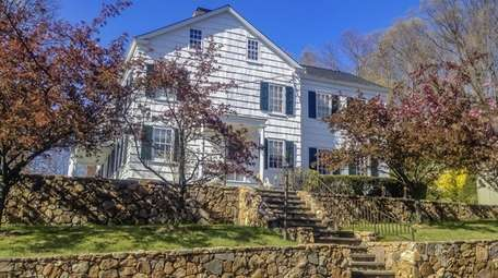 The four-bedroom, five-bathroom, one-half-bath late Federal style home