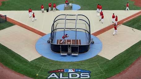 Red Sox players practice during a workout at