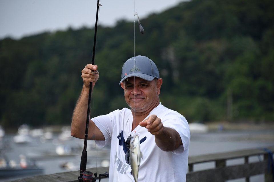 Javier Betancurt, 57, of Valley Stream, reels in