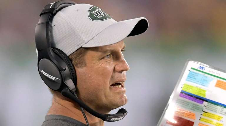 Jets offensive coordinator Jeremy Bates looks on during