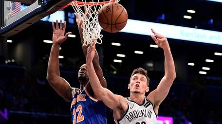 The Knicks' Noah Vonleh and the Nets' Rodions