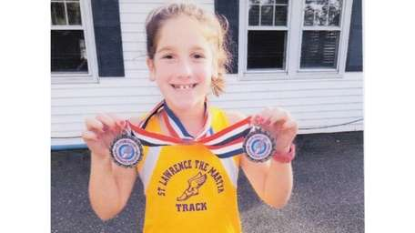 Kidsday reporter Juliana Balsamo shows her track medals.