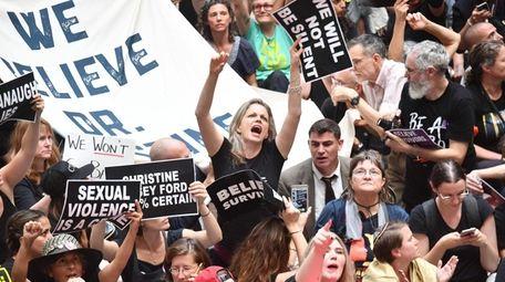 Demonstrators oppose the confirmation of nominee Brett Kavanaugh