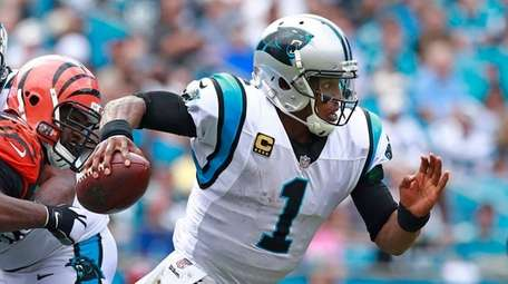 Cam Newton does what he does best, scrambling
