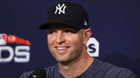 Yankees pitcher J.A. Happ speaks to reporters at