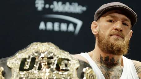 Conor McGregor speaks during a press conference for