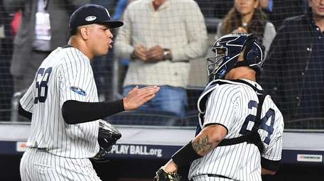 Reliever Dellin Betances and catcher Gary Sanchez react