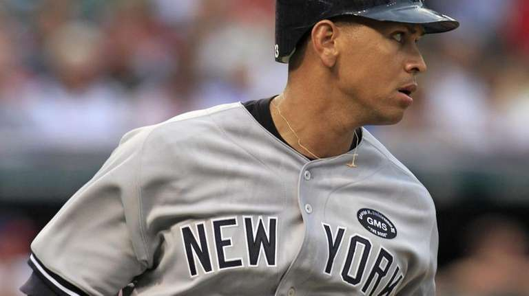 New York Yankees' Alex Rodriguez runs to first