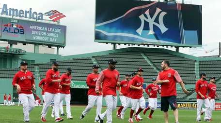 Boston Red Sox players warm up during a