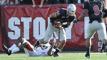 Stony Brook's Dominick Reyes intercepts a pass against
