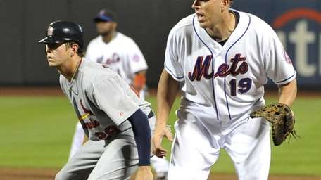Mets' first baseman Mike Hessman covers first base
