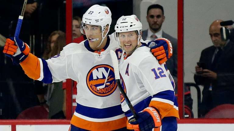 Islanders' Josh Bailey (12) and Anders Lee (27)