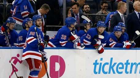 The New York Rangers bench looks on after