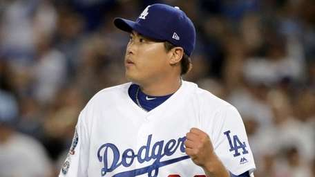 Los Angeles Dodgers starting pitcher Hyun-Jin Ryu celebrates