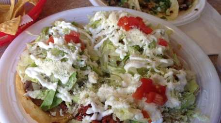 Sopes with chorizo, chicken and a combination of