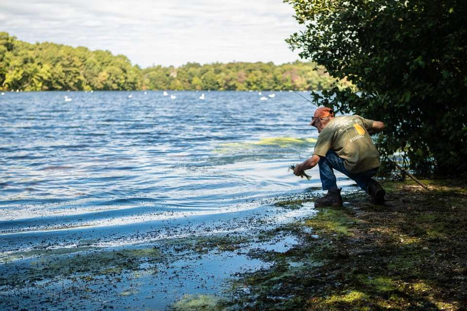 Jim of Lake Ronkonkoma releases a fish he