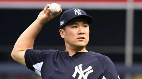 Masahiro Tanaka of the New York Yankees throws