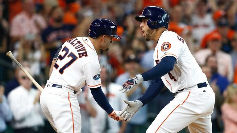 b124cfcd0 George Springer of the Astros celebrates with Jose. George Springer of the Astros  celebrates with Jose Altuve after hitting a solo home run off Corey Kluber  ...