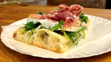 Prosciutto and arugula are two of the specialty