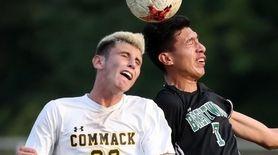 Commack's Bryan Tompkins and Brentwood's Jonathon Hernandez battle